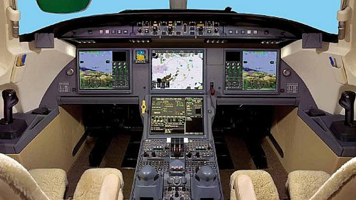 Falcon 900 business jet avionics upgrades completed by StandardAero; includes synthetic vision and graphical weather installations