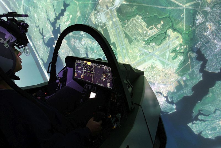U.S. Air Force pilots train for F-35 operations with linked Lockheed Martin simulators