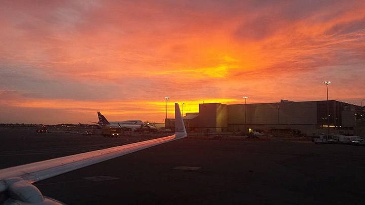 American Airlines Aircraft Maintenance Technician William Donaghey snaps a cellphone photo of a stunning sunset while working on a commercial cargo jet at Logan International Airport (BOS) in Boston. Donaghey and his colleagues were prepping the plane: 'Getting the plane ready for moving up from a North Cargo overnight spot up to the gate.' Working nights, he sees a wealth of sunrises, but this one proved particularly eye-catching.