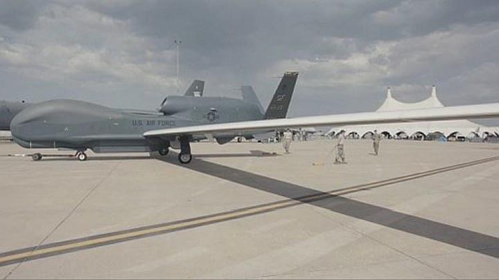 Northrup Grumman's autonomous Global Hawk aircraft lands during an airshow for the first time