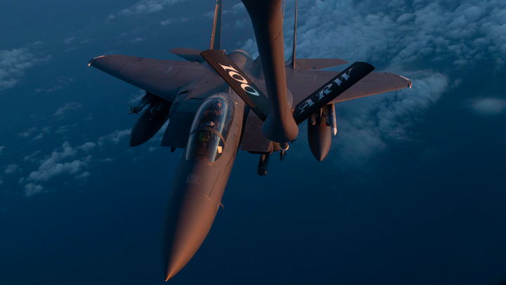 """An F-15E Strike Eagle assigned to the 48th Fighter Wing at RAF Lakenheath, U.K., receives fuel from a 351st Air Refueling Squadron KC-135 Stratotanker at RAF Mildenhall, U.K., during the """"FURIOUS 48"""" readiness exercise over the skies of England, April, 24, 2019. Exercise scenarios were designed to ensure 100th Air Refueling Wing Airmen were fully prepared for potential contingencies in the wing's area of responsibility. Boeing recently received a 10-year contract to provide the USAF with Weapon Planning Software."""