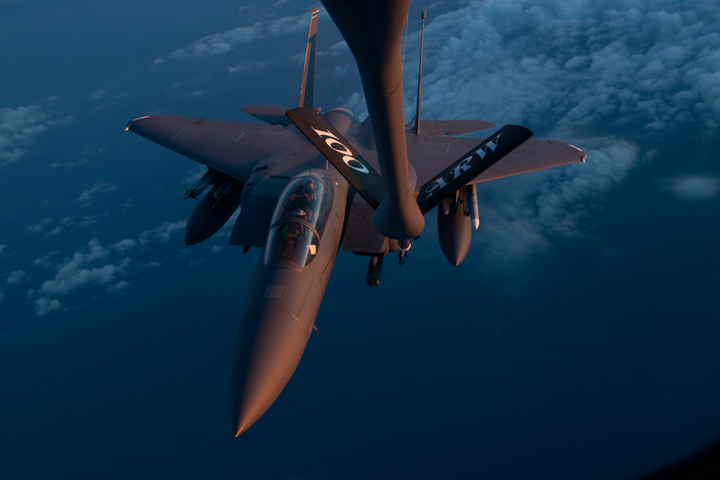 "An F-15E Strike Eagle assigned to the 48th Fighter Wing at RAF Lakenheath, U.K., receives fuel from a 351st Air Refueling Squadron KC-135 Stratotanker at RAF Mildenhall, U.K., during the ""FURIOUS 48"" readiness exercise over the skies of England, April, 24, 2019. Exercise scenarios were designed to ensure 100th Air Refueling Wing Airmen were fully prepared for potential contingencies in the wing's area of responsibility. Boeing recently received a 10-year contract to provide the USAF with Weapon Planning Software."
