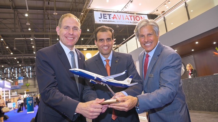 Samir Sahgal, managing director of Business & General Aviation Flight Operations and BBJ Services, Boeing Global Services (Center) presents a BBJ model to Dave Paddock, senior vice president and general manager of regional operations, USA for Jet Aviation (Left) and Don Haloburdo, vice president of flight services, USA for Jet Aviation (Right) to commemorate services agreement for Jeppesen Operator with Boeing at EBACE airshow in Geneva.