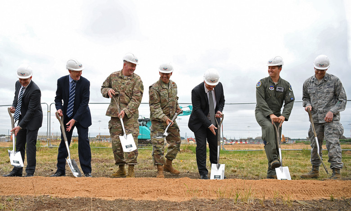 Gen. Jeffrey L. Harrigian, U.S. Air Forces in Europe and Air Forces Africa commander, (center), poses for a photo with 48th Fighter Wing personnel and local civic leaders, partners and contractors during an F-35 Lightning II groundbreaking ceremony at RAF Lakenheath, U.K., July 15, 2019. The groundbreaking follows the ongoing construction projects that will facilitate two F-35A squadrons, making RAF Lakenheath the first permanent international site for U.S. fifth generation aircraft in Europe.