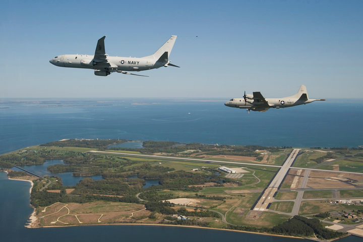 The U.S. Navy's maritime patrol and reconnaissance test aircraft P-8A Poseidon flies with a P-3C Orion along side, prior to landing at Naval Air Station Patuxent River, Md.