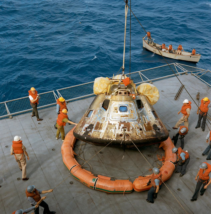 The Apollo 11 spacecraft Command Module is photographed being lowered to the deck of the U.S.S. Hornet, prime recovery ship for the historic lunar landing mission. Note the flotation ring attached by Navy divers has been removed from the capsule. Fifty years after humanity's first manned mission to the moon, some of Earth's smaller nations have embraced ambitions of reaching space.