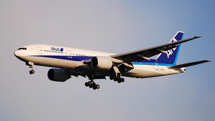 """A 777 owned by All Nippon Airways (ANA) has its landing gear down as it comes in for a landing. Boeing will outfit a 777 as its """"ecoDemonstrator"""" for more than 50 technologies."""
