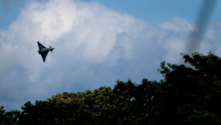 RAF Typhoons, like the one pictured above, were scrambled to escort a passenger plane safely to the airport after a passenger became unruly. Damage to buildings was reported to the UK MoD after the jets went supersonic in catching up with the passenger jet.